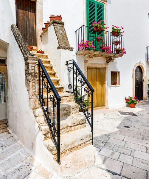 Locorotondo, Italy. Medieval whitewashed street and houses in small city of Puglia, Apulia, Bari region.